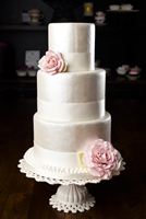 Three tier antique pearl finish cake with pink gumpaste roses